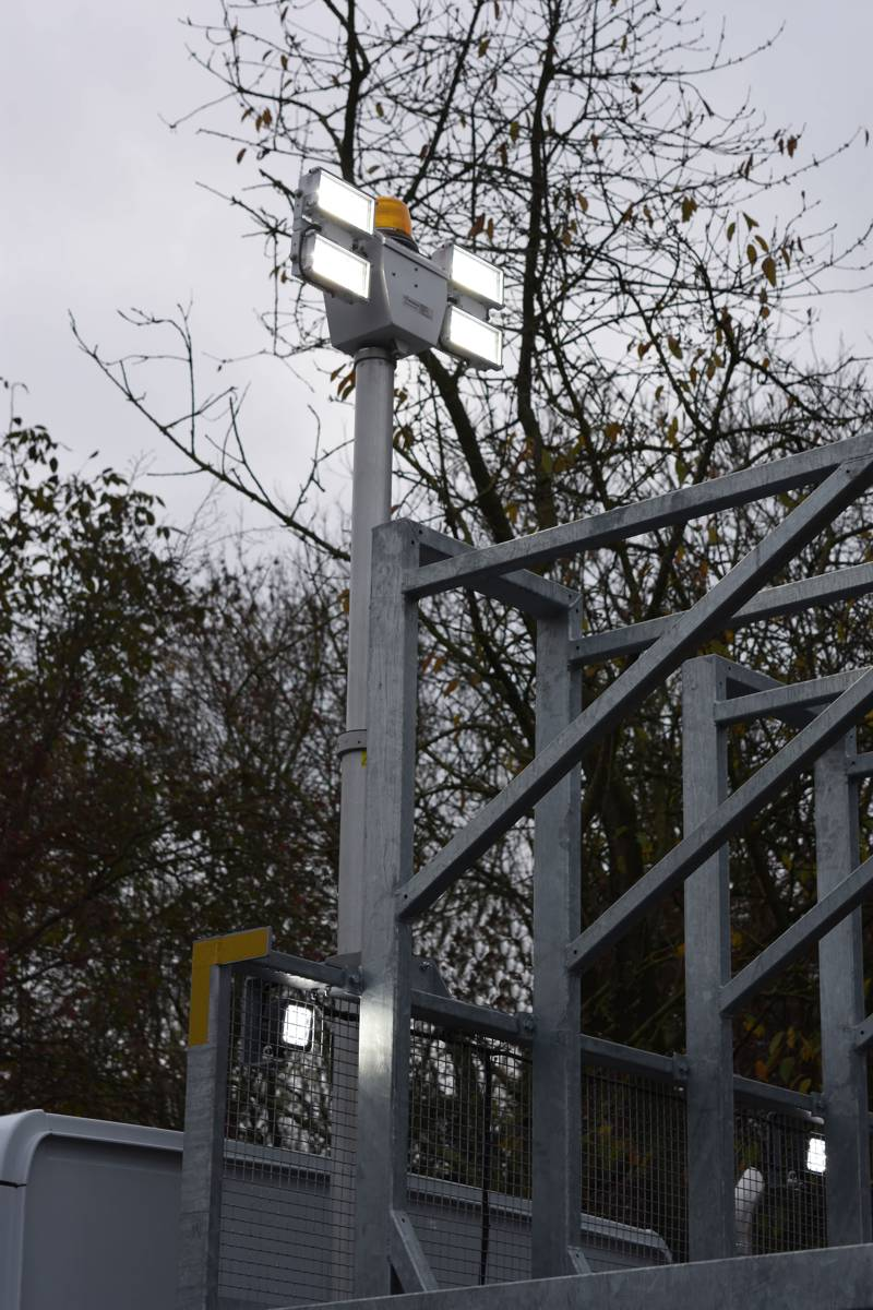 Truck mounted floodlight system designed to protect road workers at night