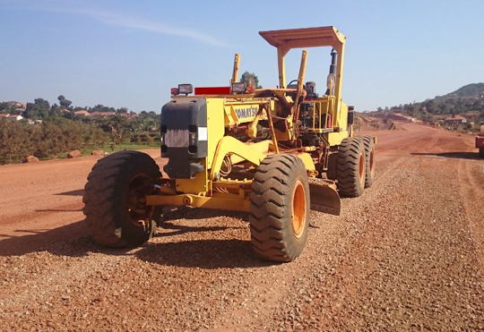 A Komatsu GD663A-2 motor grader at work in Uganda