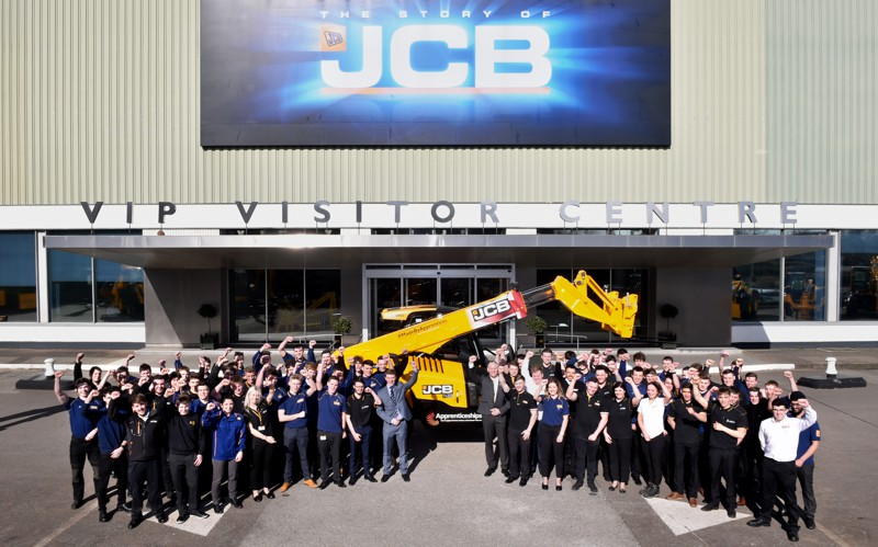 JCB Apprentices celebrate after the reveal of the Loadall Built by Apprentices