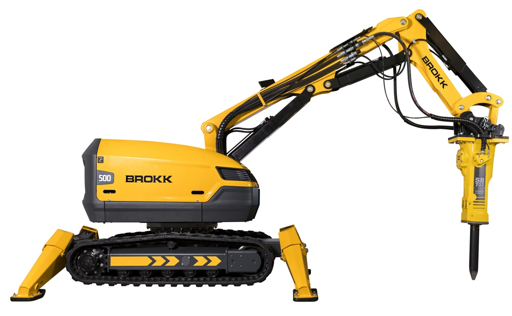 The new Brokk 500 delivers 1,086 foot-pounds (1,472 joules) with each blow of the 1,510-pound (685-kilogram) Atlas Copco SB 702 hydraulic breaker. On top of that, it adds length to Brokk's signature three-part arm system, which now extends 24.3 feet (7.4 meters) vertically and 23 feet (7 meters) horizontally.