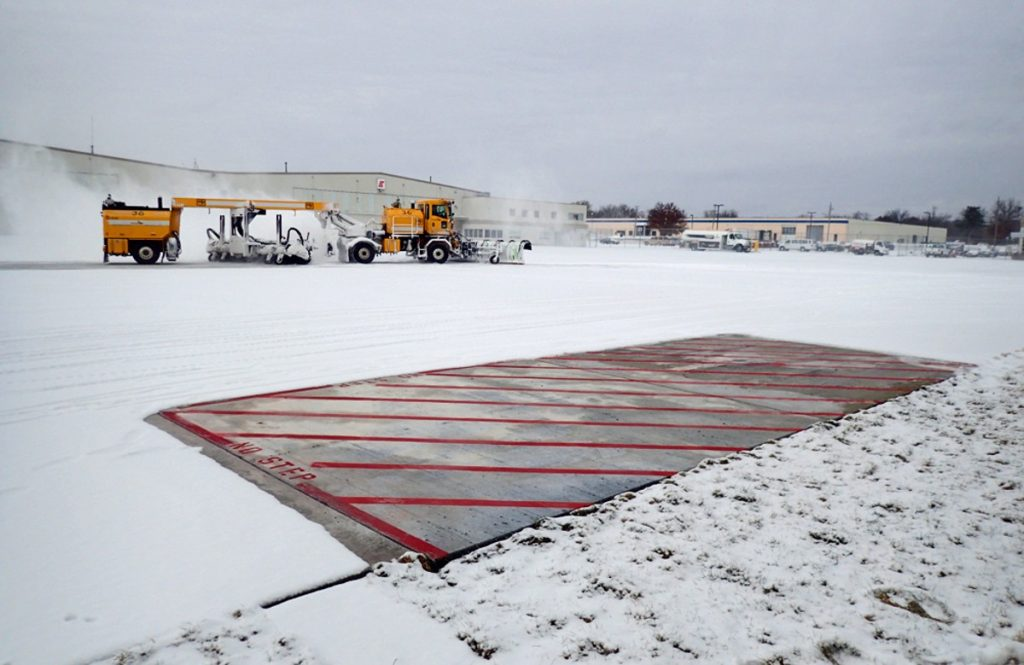 Iowa State engineers don't need a plow to clear snow from the heated test slabs they installed at the Des Moines International Airport. Photos courtesy of Halil Ceylan.