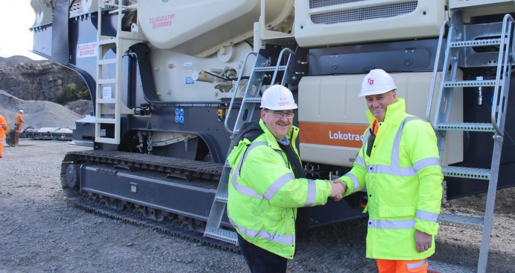 Mr. David Strachan, Quarry Manager Northfield Quarry, Tillicoultry Quarries, received the keys from Mr. Michael Broe, Director, Garriock Bros. Ltd.
