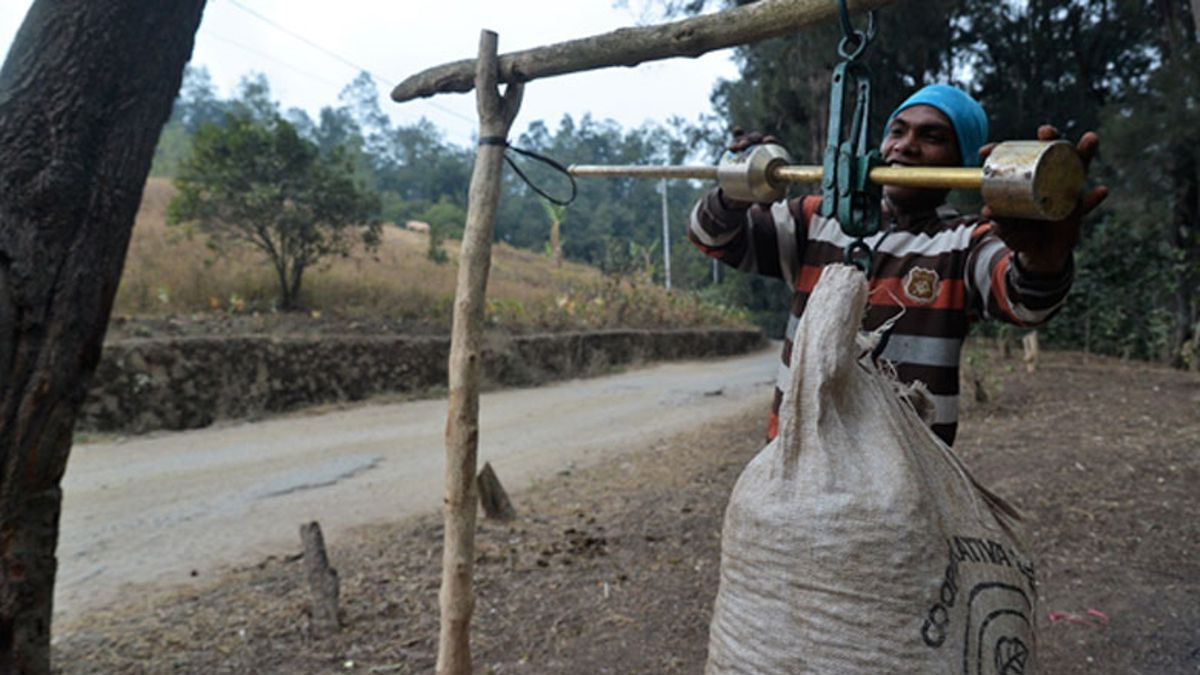 Fresh coffee beans from Timor-Leste's central highlands are weighed along the side of the Dili-Ainaro Road.