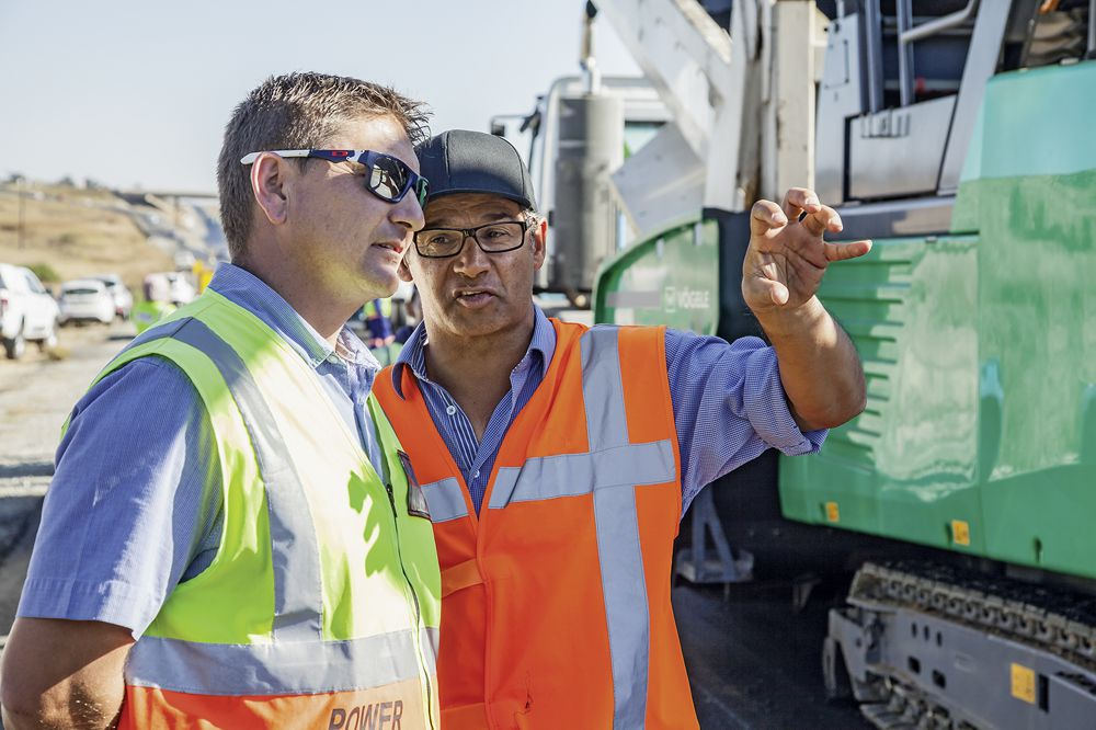 """""""With the MT 3000-2 Offset, the temperature of the asphalt immediately after paving never fell below 120°C, which left a huge window of time for final compaction."""" Dr Seirgei Miller, University of Twente (on the right)."""