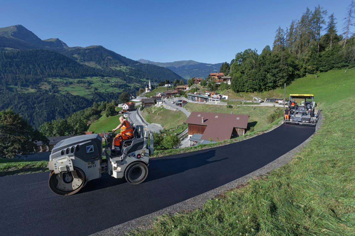 The steep climbs of the Swiss Alps are no match for Vögele's Super 1803-3i wheeled paver