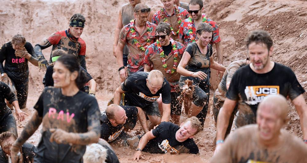 A record-breaking - and capacity - field of 3,000 squirmed and splashed their way to a £70,042 charity total by taking on the challenge of the 6th annual JCB Mud Run.