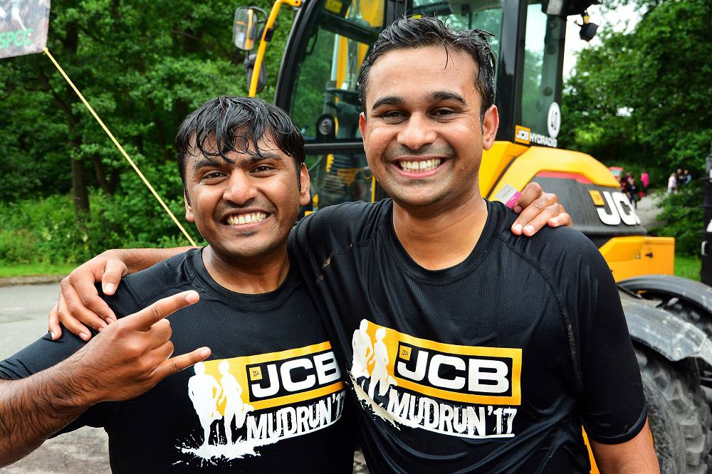Engineers Dhanraj Veer, 28, and Ajay Mahajan were visiting the UK from JCB's factory in Pune, India and decided to take part in the JCB MUD RUN.
