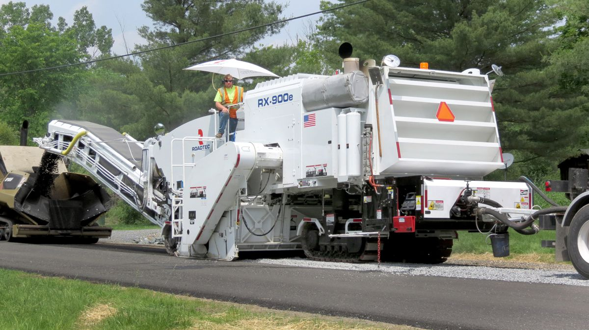 Cold-in-place recycling additive system allows milling and paving a roadway in a single process