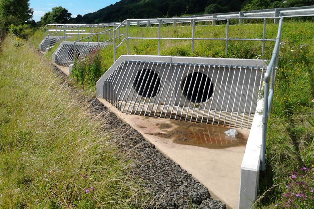 New drainage culverts under the road show how high the carriageway has been raised