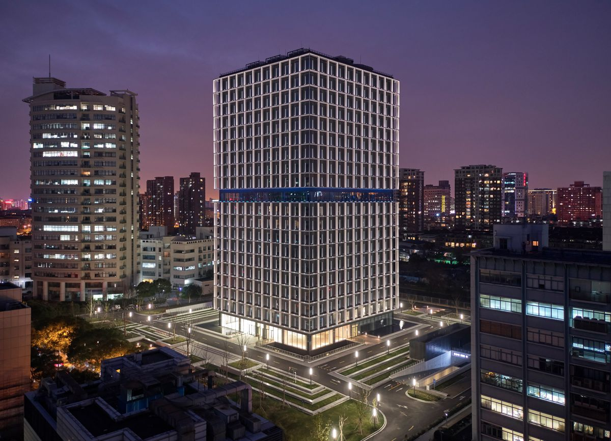 Architectural lighting turns the OnCube office complex in Shanghai into a landmark