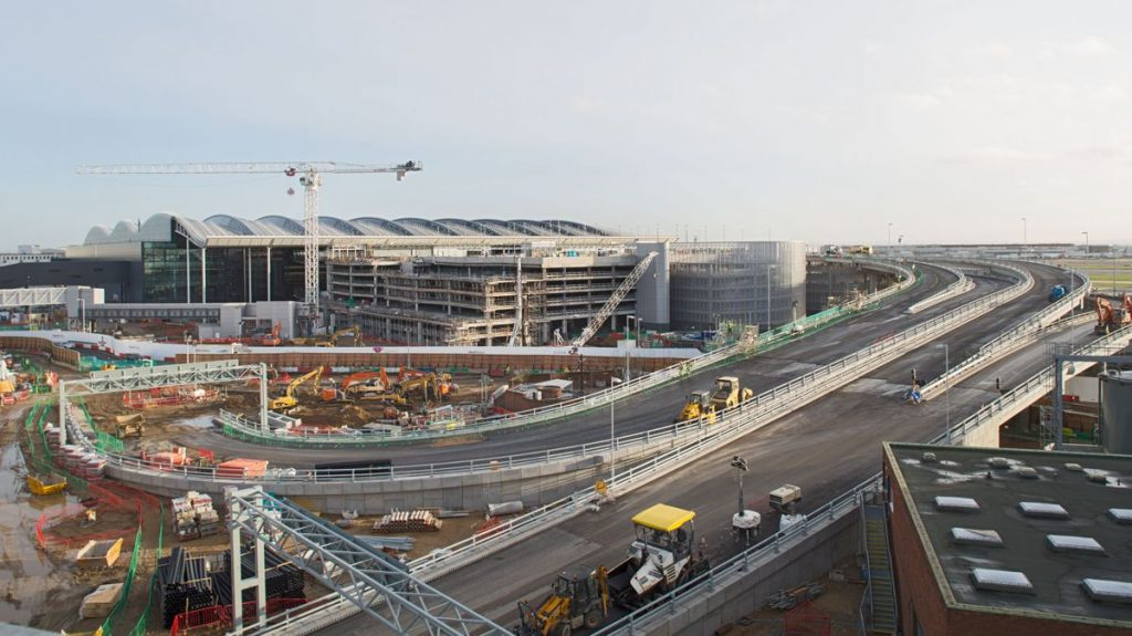 Heathrow, T2 development nearing completion, view of T2A, MSCP (muliti-story car park) and road ramp, 20 December 2013.
