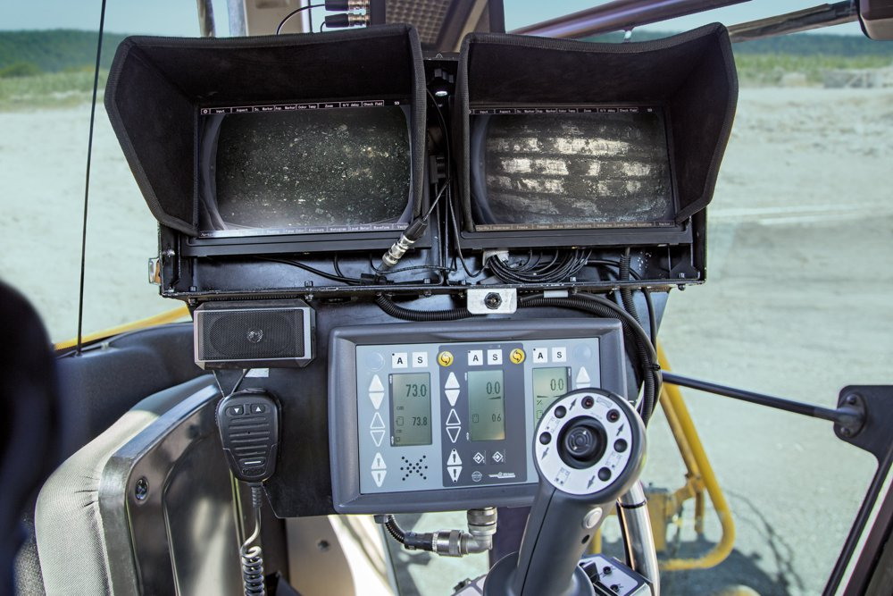 The Wirtgen camera system is installed to optimize selective mining. Two cameras, mounted on the left and on the right behind the cutting drum, transmit 1:1 photos of the surface to a double monitor in the cabin, allowing the Surface Miner operator to exactly adjust the cutting depth.