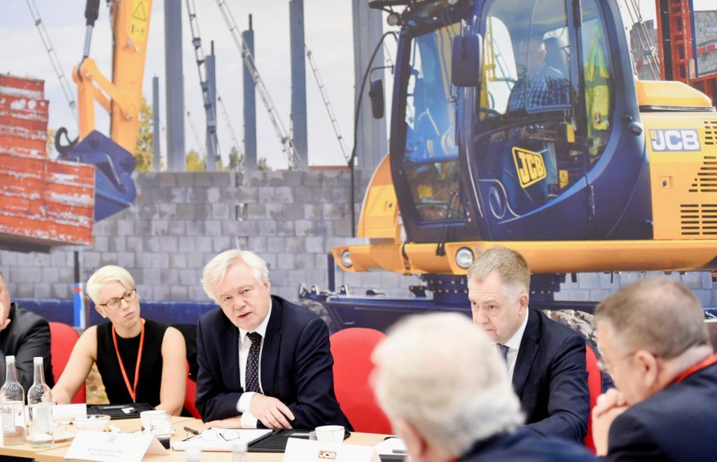 David Davis visits JCB to reassure British business as Brexit talks enter key stage