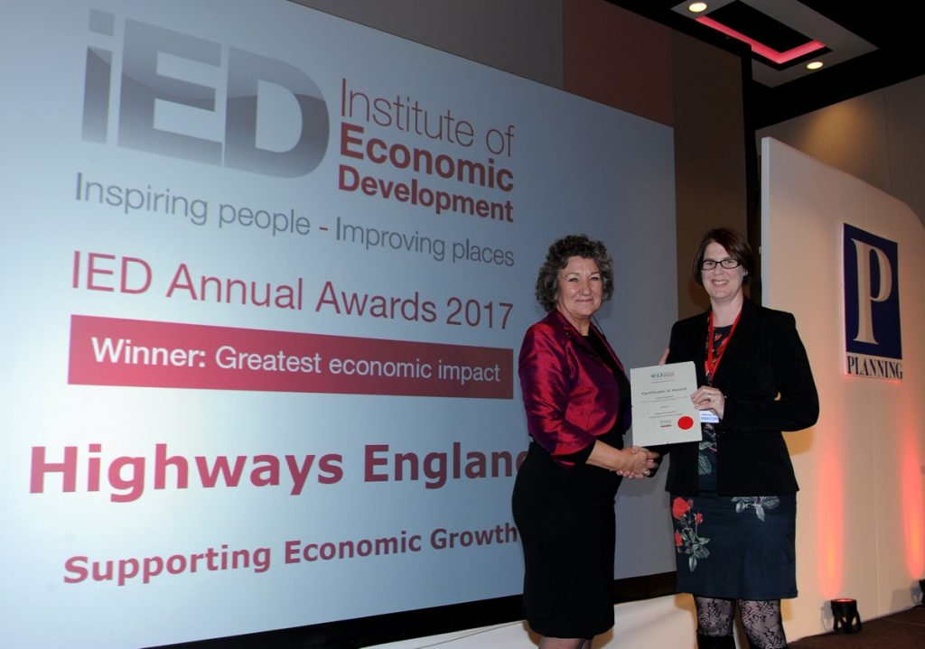 Highways England's Senior Strategic Implementation Manager Alice Darley receiving the award