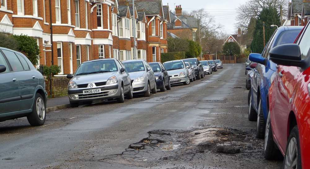 Pothole in the road - Photo by Henry Burrows