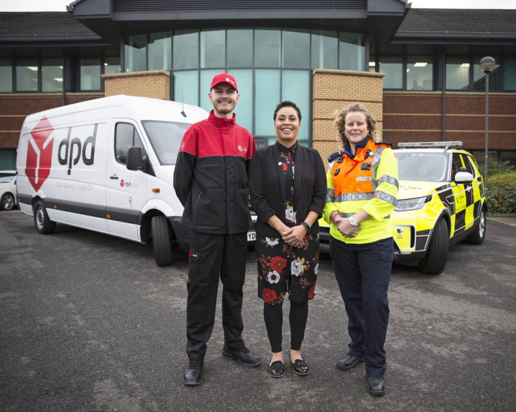 Finn Owens from DPD with Highways England customer service director Melanie Clarke and Highways England traffic officer Vicki Lawton who will be working on Christmas Day to keep traffic moving on the Midlands motorway network.
