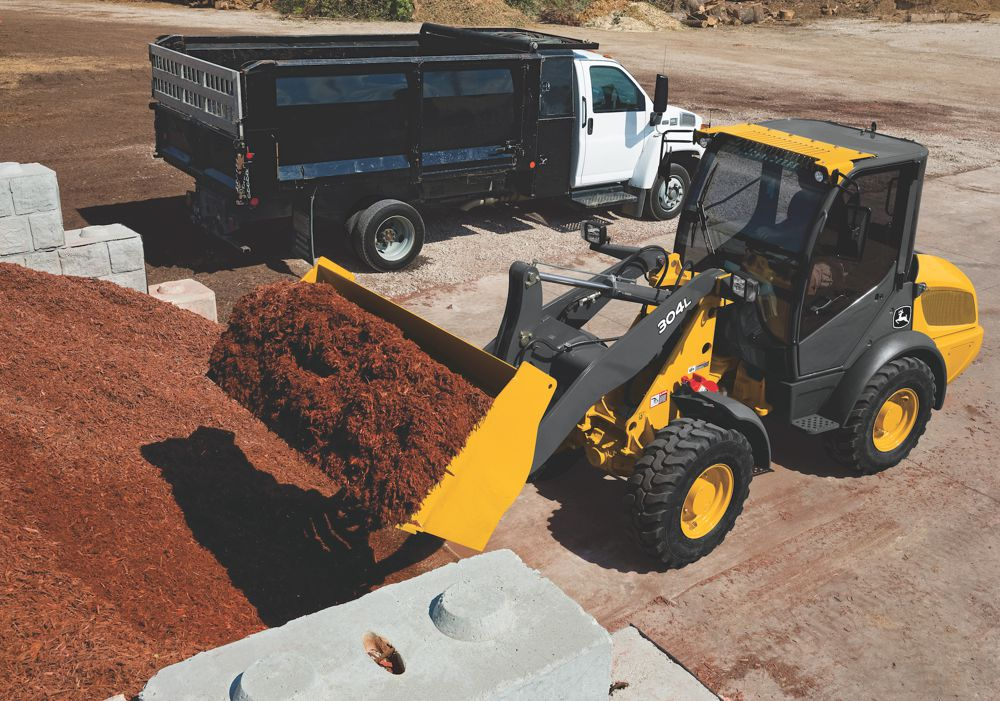 New John Deere L-Series Compact Wheel Loader tackle the toughest tasks
