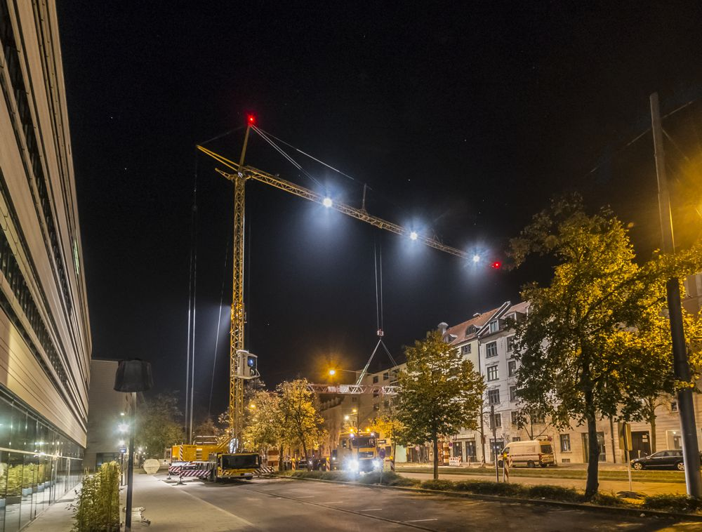 The Liebherr MK 88 Plus mobile construction crane operated by Schmidbauer GmbH & Co. KG dismantled a cable bridge at night.