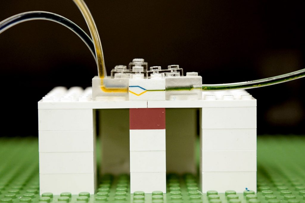 MIT researchers have developed a new platform for microfluidics, using LEGO bricks. Shown here, fluid flows through tiny channels milled into the side walls of LEGO bricks. Image: Melanie Gonick/MIT