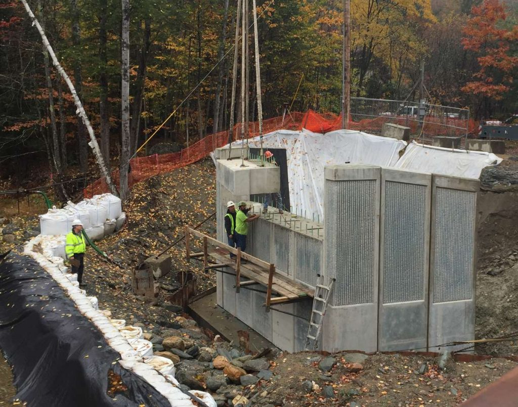 Mass DOT Replaces Savoy Road Bridge over the Chickley River Using Accelerated Bridge Construction. Bridge substructure is composed of all precast concrete bridge components for fast-track construction