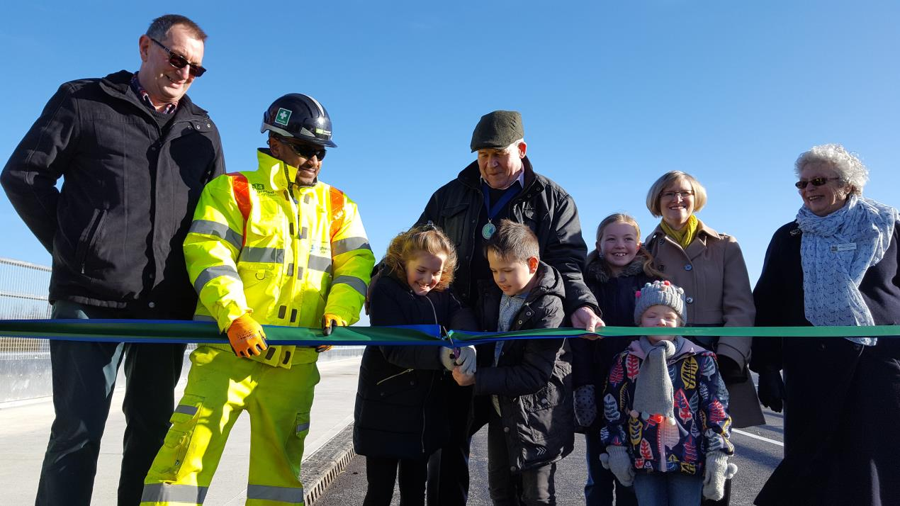 The new Brampton Road bridge being officially opened by Brampton Parish Council Chairman Cllr Simon Jordan and family on Monday 12 February 2018.