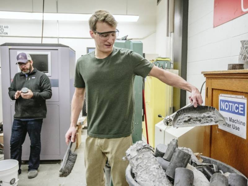 Professor Mike Berry, left, and student researcher Riley Scherr perform compression tests on ultra-high performance concrete on Jan. 11, 2018, at Montana State University. MSU Photo by Adrian Sanchez-Gonzalez
