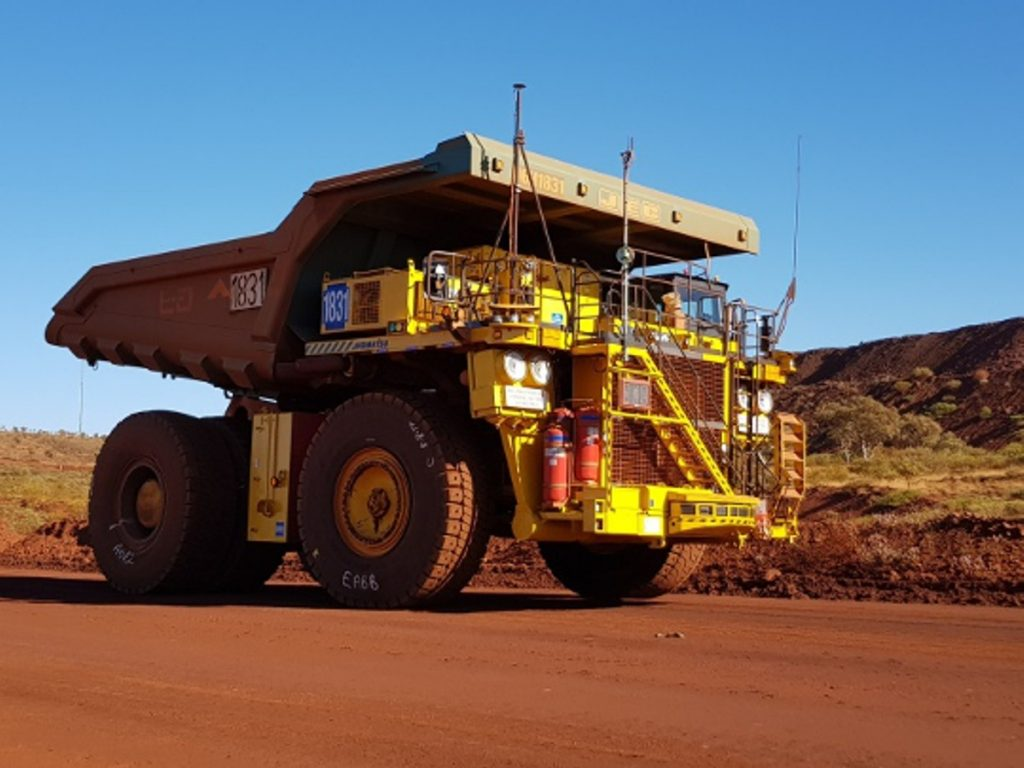 A standard truck 830E with the AHS retrofit kit running in autonomous mode at Rio Tinto's mine in Australia