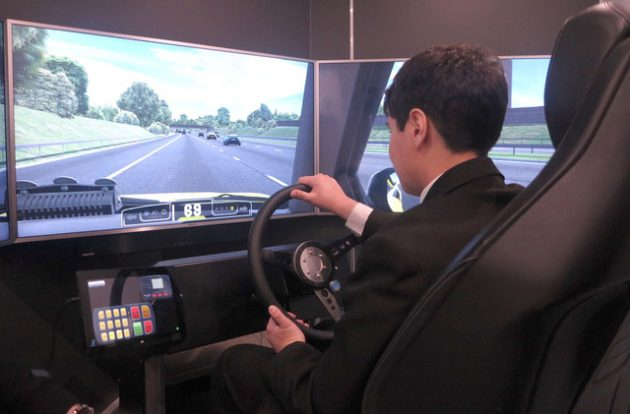 A Big Bang Fair visitor experiences the Highways England simulator