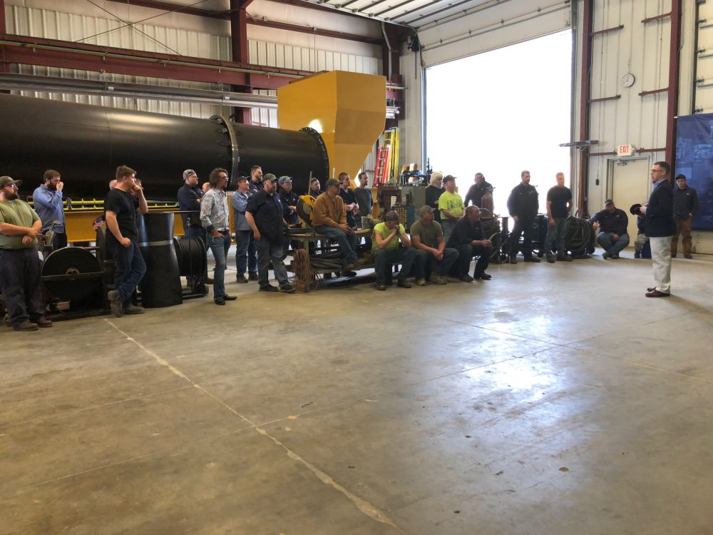 U.S. Representative Jim Banks holds a question-and-answer session with Asphalt Drum Mixers employees. Workers brought up topics important to them, including steel tariffs and the farm bill. Image courtesy of Asphalt Drum Mixers