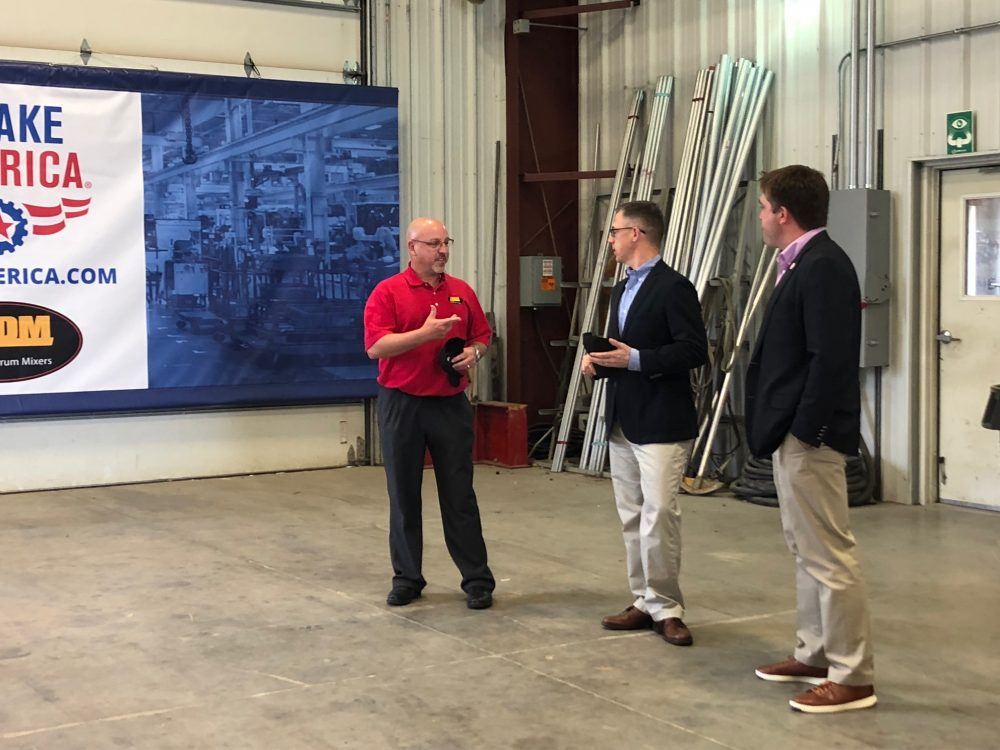 U.S. Representative Jim Banks (middle) speaks with Asphalt Drum Mixers President Mike Devine (left) and AEM Vice President, Public Affairs & Advocacy Kip Eideberg (right) about topics important to the manufacturing industry. Image courtesy of Asphalt Drum Mixers