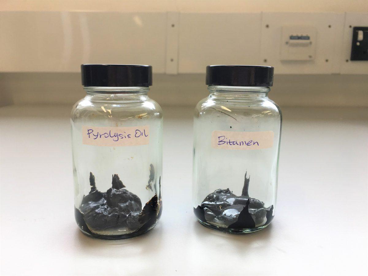 Jars showing the visual similarity between traditional bitumen (right) and bio-bitumen (left)