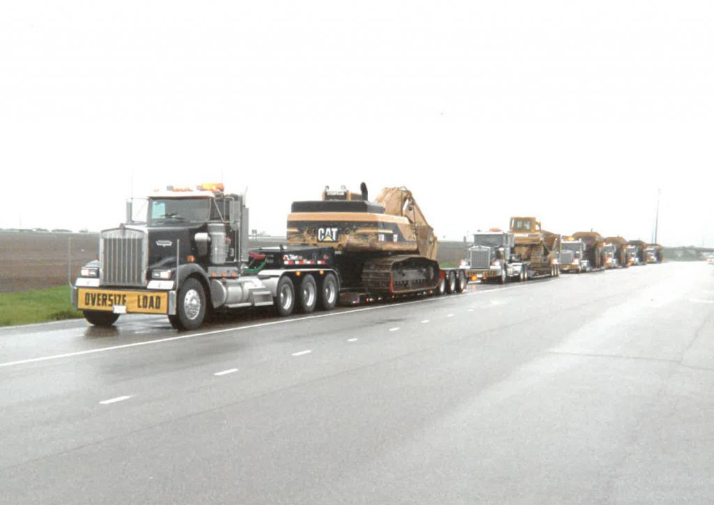 """Off-the-shelf"" heavy-haul type trailers allowed Catom Trucking to get by in the early days of the business, but as clients' equipment grew, so did the need for a custom solution. That's when the company turned to Talbert Manufacturing for a solution, such as this 55-ton trailer that features raised rails with neck extension as well as a 3-axle jeep and a stinger for a 3+3 rear configuration. (Photo Courtesy of Catom Trucking)"