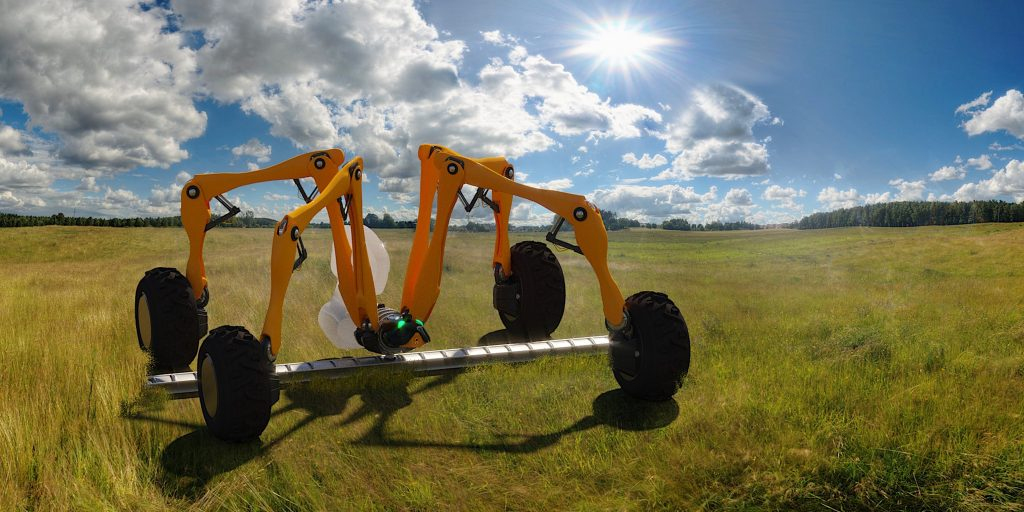 Yellow arachnid robot in the field. Caption/info: Our Harry digital planting robot recently won a prestigious Horizontal Innovation™ Award from the Institution of Engineering and Technology (IET) and the High Value Manufacturing Catapult (HVMC) to develop the prototype technology. Harry will accurately place seed individually in the ground at a uniform depth to within 2cm accuracy, creating a plant level map showing the location of each seed. By punch-planting rather than ploughing, Harry will also radically reduce soil run off and associated water pollution. With a three metre boom, Harry has an 'arachnid' design, enabling it to fold up compactly for transport by transit van.