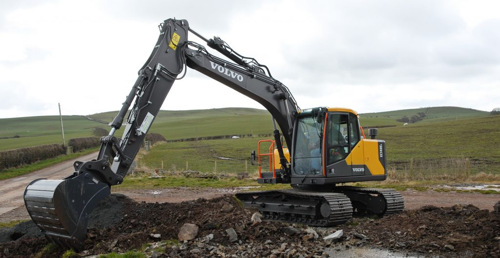 Volvo EC140E Excavator gets stuck in down on the farm