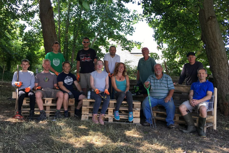 The Highways England team, including assistant project manager Karl Sullivan fourth left, and Chacewater villagers, with Rob Knill third from right, and the team busy clearing vegetation