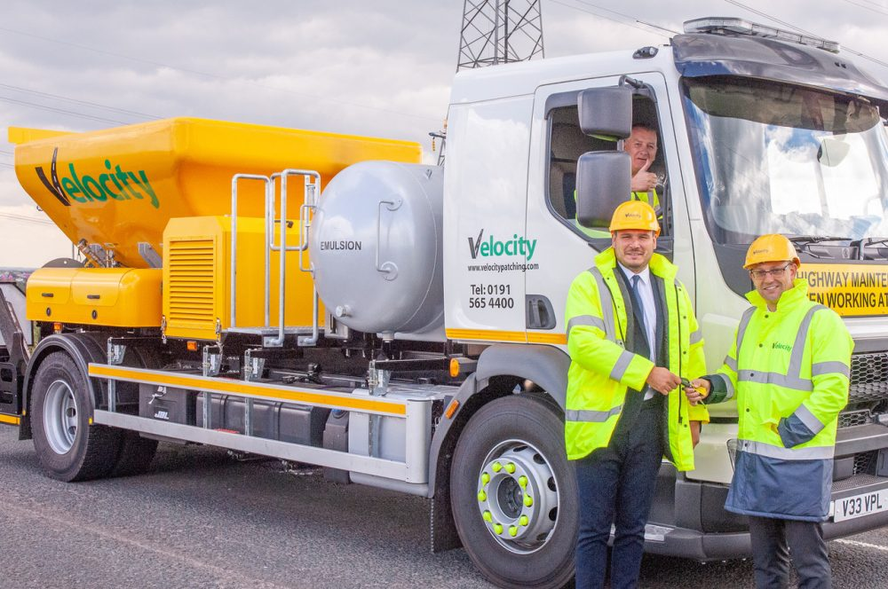 Velocity's UK sales manager Leon Ryan receives the new machine from managing director Dominic Gardner