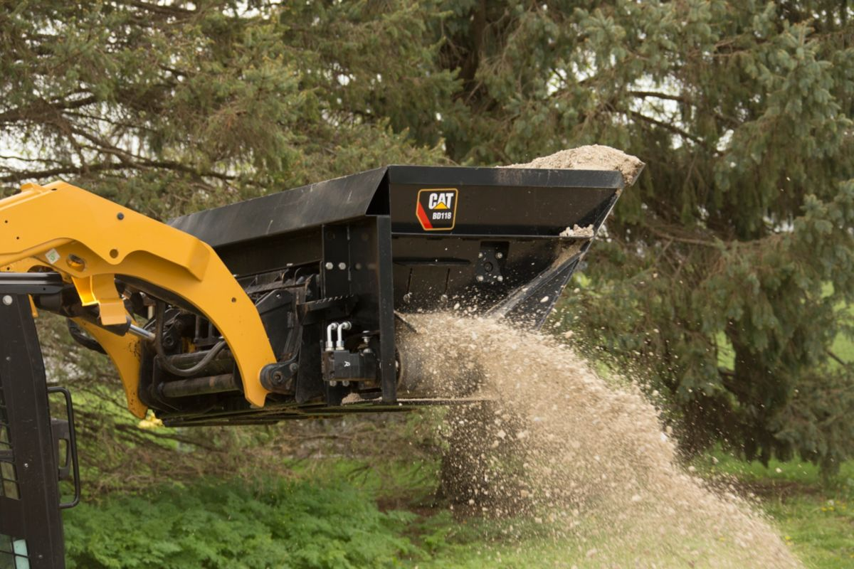 Cat heavy-duty side discharge buckets deliver controlled flow of loose materials