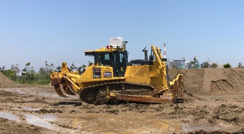 Dozer being remotely operated by special cockpit via 5G at Komatsu Tokyo IoT Center in Chiba City