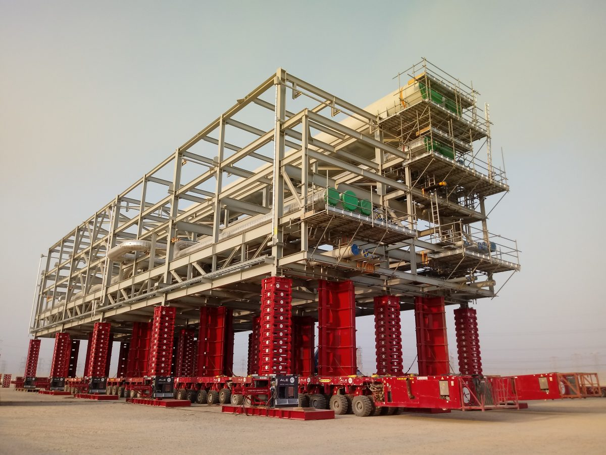 ALE's Mega Jack 300 jacking-up a 615t pipe rack module 5.9m using 15 bases with SPMTs underneath.