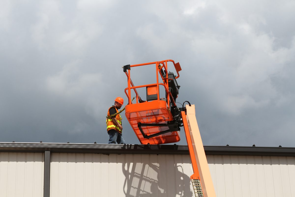 JLG external bolt-on fall arrest system allows operators to work outside the platform