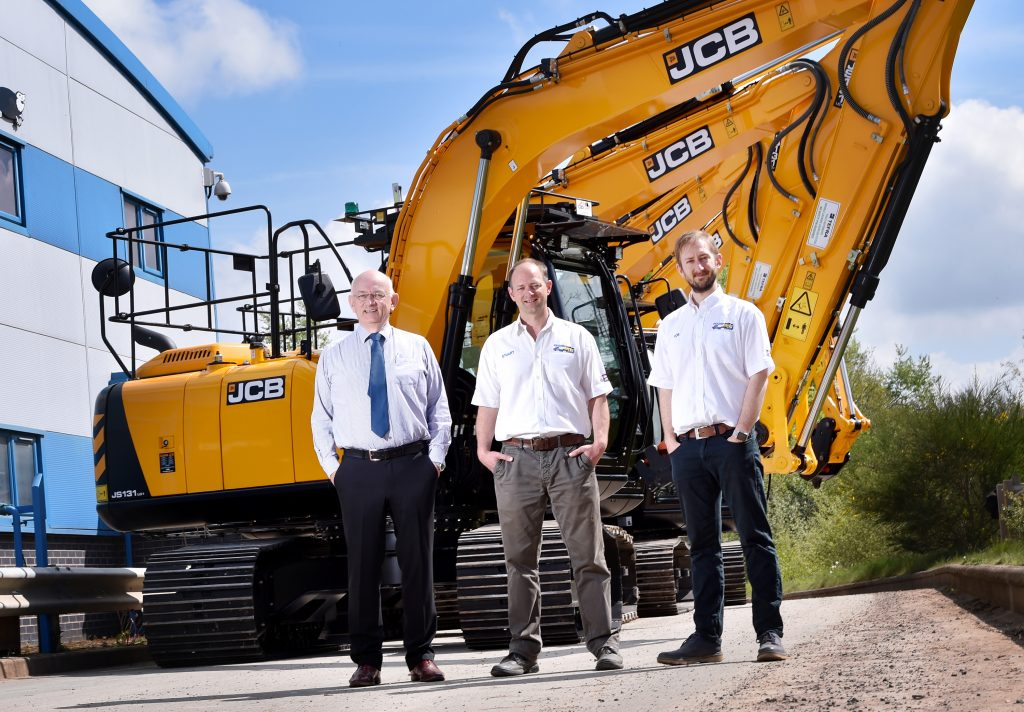 Pictured left to right is Ridgeway Rentals Group Chair Tim Jones, John Dolphin from Gunn JCB Sales, MD Stuart Jones and Director Rob Jones with JCBs outside Ridgeway Rentals Ltd, Oswestry.