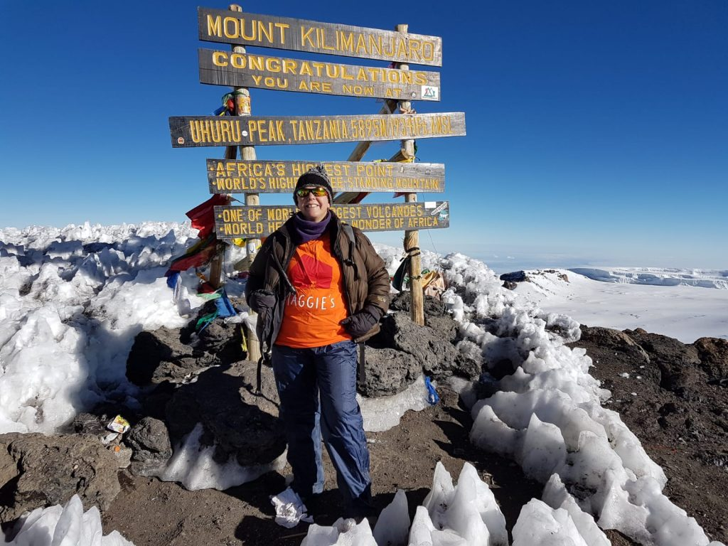 Tina at the Summit of Kilimanjaro in her Maggie's T Shirt