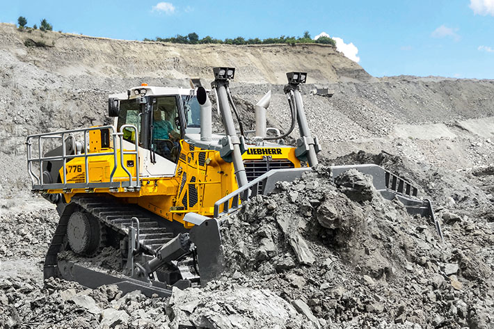 The Liebherr PR 776 crawler tractor is designed for tough mining and quarry operations. It features an infinitely variable hydrostatic travel drive, which is unique in the 70 tonnes category.