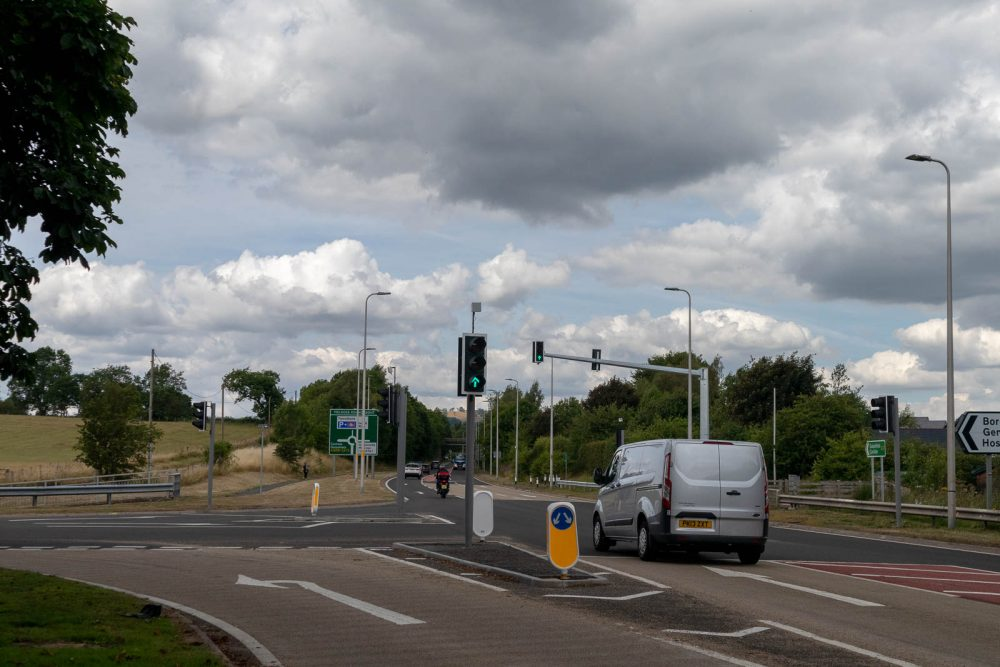 An innovative scheme integrating wireless vehicle detection traffic signals, vehicle activated signs (VAS) and a hurry call system has reconfigured a hospital junction to address safety concerns and assist ambulance response times.