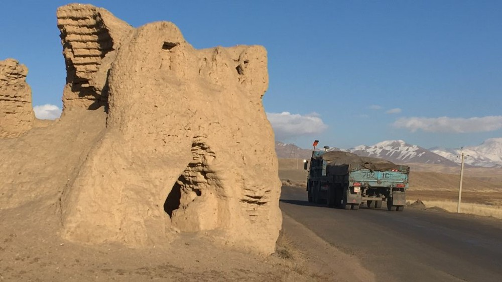 A view of the existing road along the North–South Alternate Corridor in Kyrgyz Republic. The road passes some historic burial structures, which will be conserved and protected during construction of the new road. ADB's Safeguard Policy addresses environmental and social risks in development projects and seeks to minimize and mitigate, if not avoid, adverse project impacts.