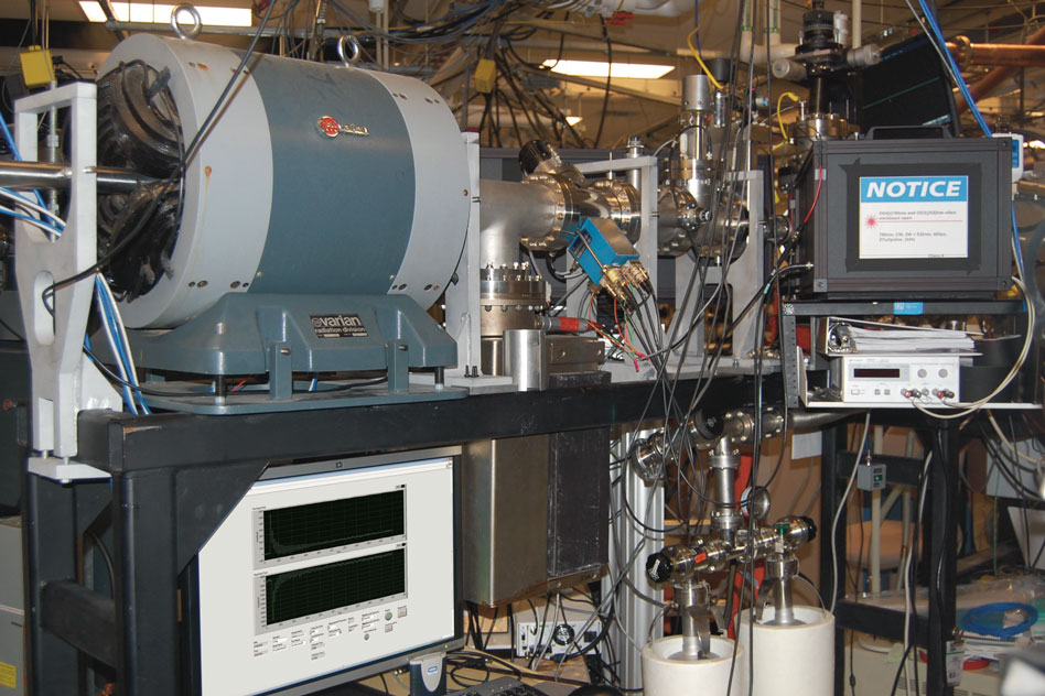 The ion beamline at Sandia National Labs where the new radiation damage measurement system has been installed and tested. The radiation damage process is observed in a target chamber located behind the black-box laser enclosure on the right of the image.  Image: Cody Dennett