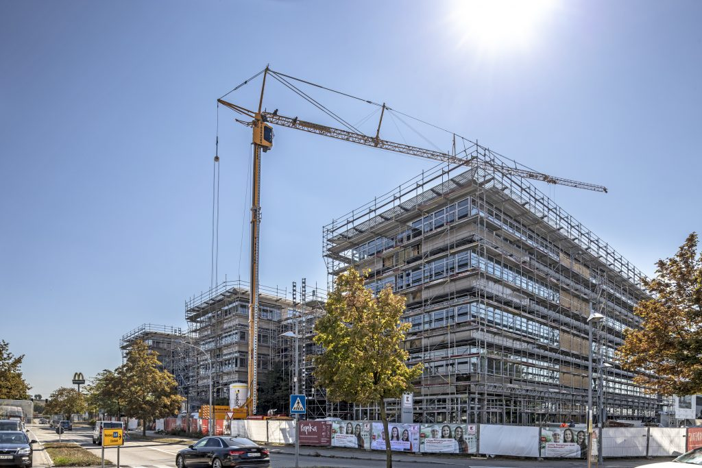 Expert engineers work with Liebherr mobile construction cranes to tackle building retrofit