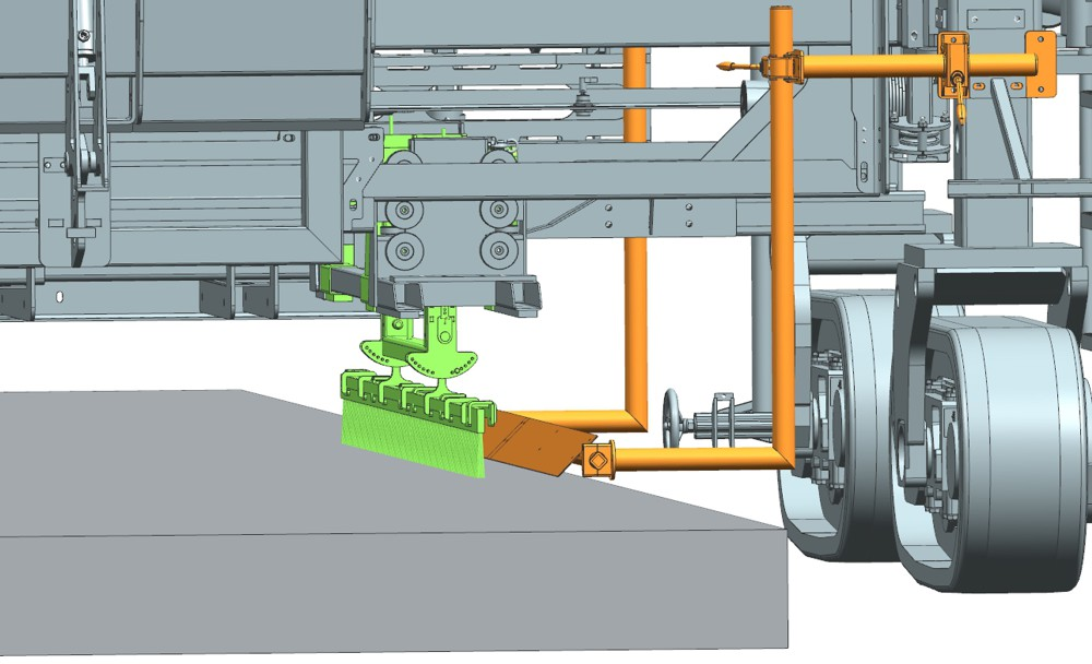 The lateral brush-cleaning unit of the TCM 180i removes slurry build-ups which adhere to the brush during changes of direction when applying a transverse brush finish. Before the brush is lowered back down to the concrete surfacing, it is set to the optimum angle of incline via the adjustable system to meet customer requirements. This prevents deep impressions which might damage the edge of the concrete pavement.