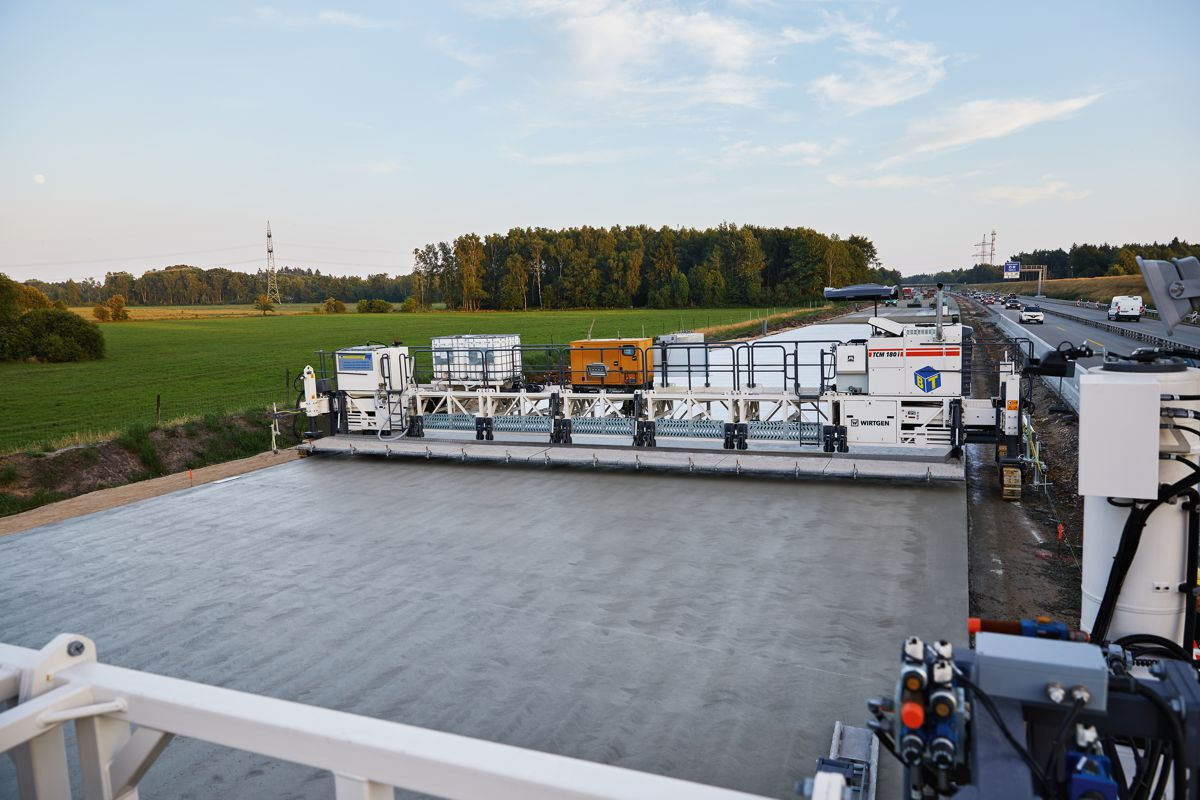 Wirtgen slipform pavers and TCM 180i texture curing machine perform on the A7