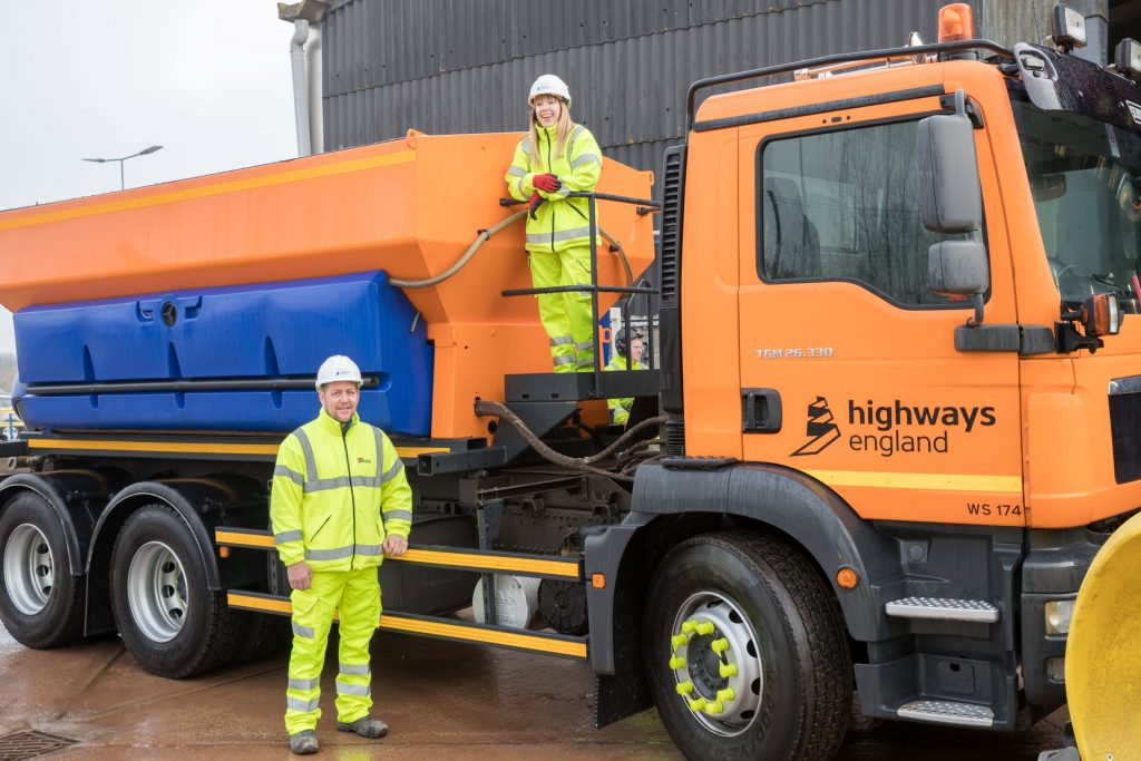 Karen and Neil next to one of the gritting machines being used to keep motorways moving this winter